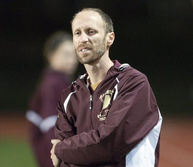 Algonquin Regional field hockey coach Dan Welty watches his players battle Longmeadow in a Division 1 state semifinal in 2011.