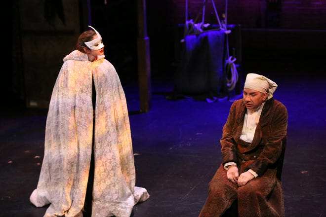 """Viktoria Chiappa as a ghost and Steve Gagliastro as Scrooge in a scene from """"A Christmas Carol Reimagined."""""""