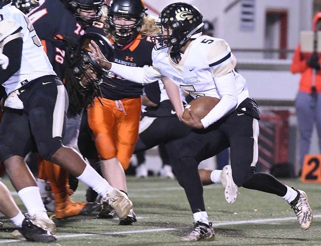 Gray's Creek running back Jerry Garcia (5) is set to return for a spring season with the Bears. Like the Richmond signee, many high school football players across North Carolina are having to choose to stay or go.