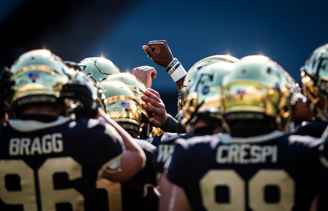 Wake Forest players huddle during pregame warmups prior to the Virginia game in October.