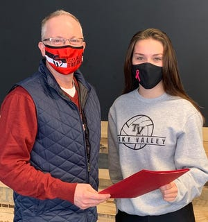 Tuscarawas Valley Local School District recently announced that senior Kaya Russell is a semi-finalist for the National Merit Scholarship Program. Pictured, from left: Superintendent Mark Murphy and Kaya Russell.