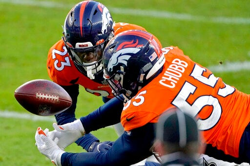 Denver Broncos outside linebacker Bradley Chubb, right, and cornerback Michael Ojemudia can't hold on to an incomplete pass against the New Orleans Saints during the second half last Sunday in Denver. (AP Photo/Jack Dempsey)