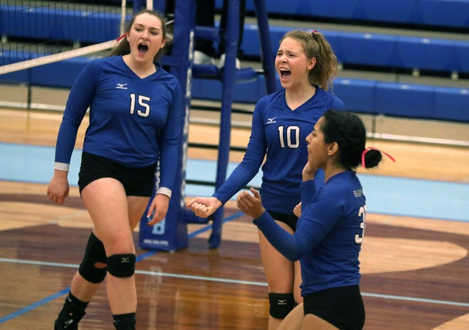 Bishop Ready High School's Kaitlyn Lancia (15), Claire Larger (10) and Mercy Cala-Avila celebrate a point scored against host Olentangy Berlin High School on Oct. 12.