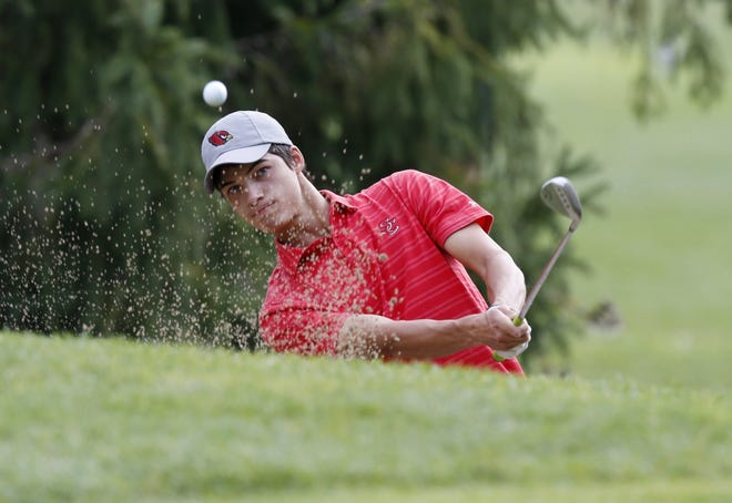 St. Charles' Luke Gutman chips on to the No. 4 green during the Central Catholic League golf tournament Sept. 26 at the Denison Golf Club.