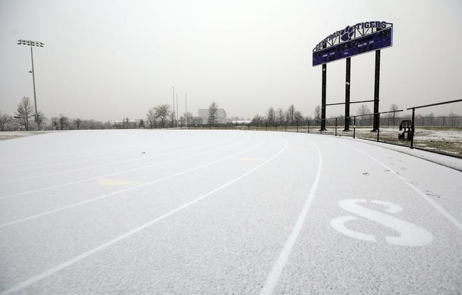 Snow covers the new eight-lane track for Pickerington High School Central on Dec. 16. The district hopes the facility, which is on a 66-acre site adjacent to the high school along Lockville Road, can be used for the spring track and field season.