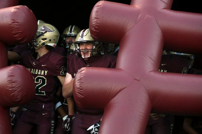 New Albany High School's Hayden Wendt yells out before running onto the field with teammates for a home game against Pickerington North on Sept. 25.