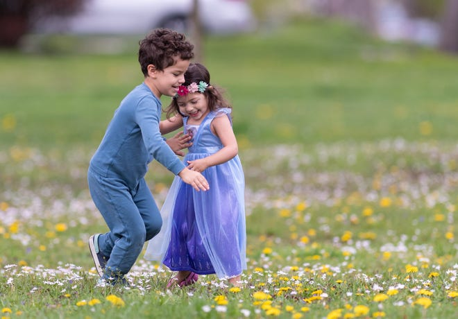 Dylan Diaz, 5, and his sister, Isabela Diaz, 2, both of Clintonville, enjoy some time together April 28 at Brevoort Park. The pair were at the park with their mother, Amy Pahoundis.