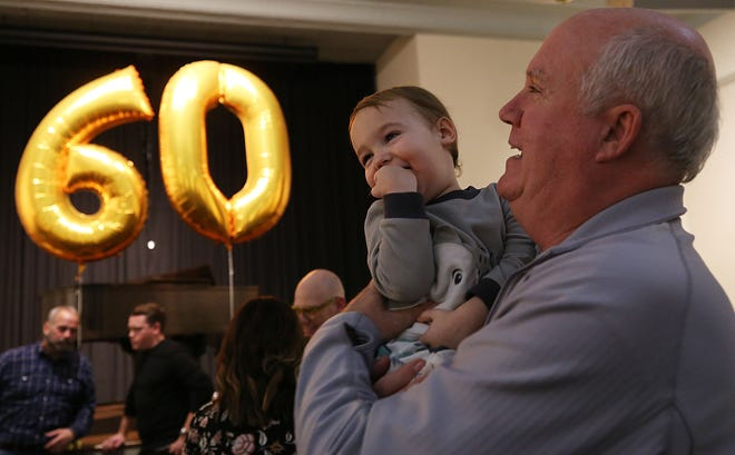 Auggie Stock, 2, and his grandfather, Tom Stock, have some fun at the cake contest held Jan. 10 at the German Village Society Meeting Haus as part of the society's 60th-anniversary celebration.