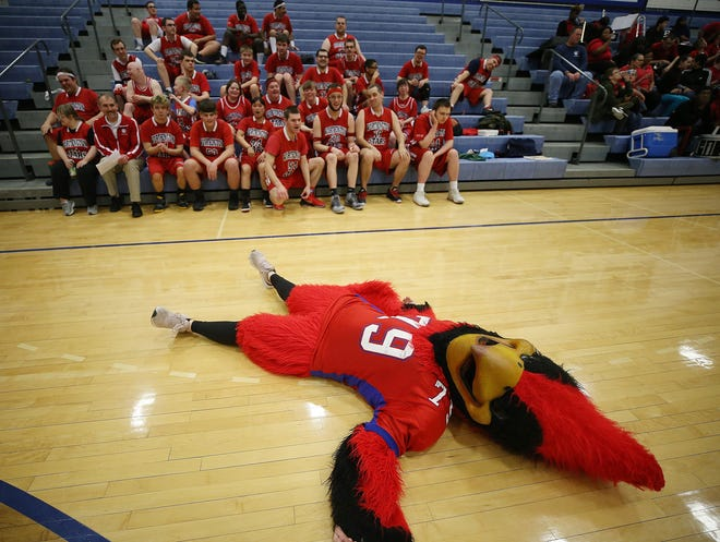 The Thomas Worthington Cardinal mascot, portrayed by Reilly Herold, has some fun with the Worthington Stars basketball team during the Battle of Worthington on March 3 at Worthington Kilbourne High School. The annual Battle of Worthington is a friendly exhibition game between the Stars, made up of players from the Worthington Special Olympics team, and the Ambassadors, featuring players from Worthington's middle schools.