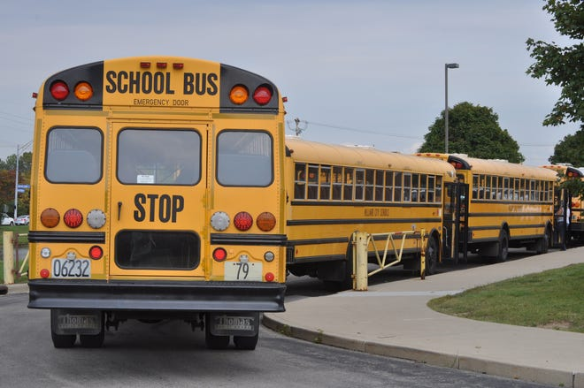 Hilliard City Schools buses line up to pick up students.