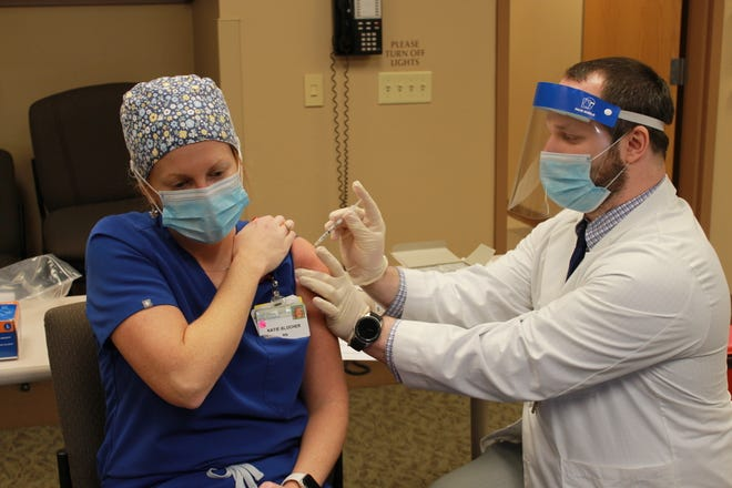 Katie Blocher, RN, second floor, was the first frontline healthcare worker at OGH to receive the vaccine.