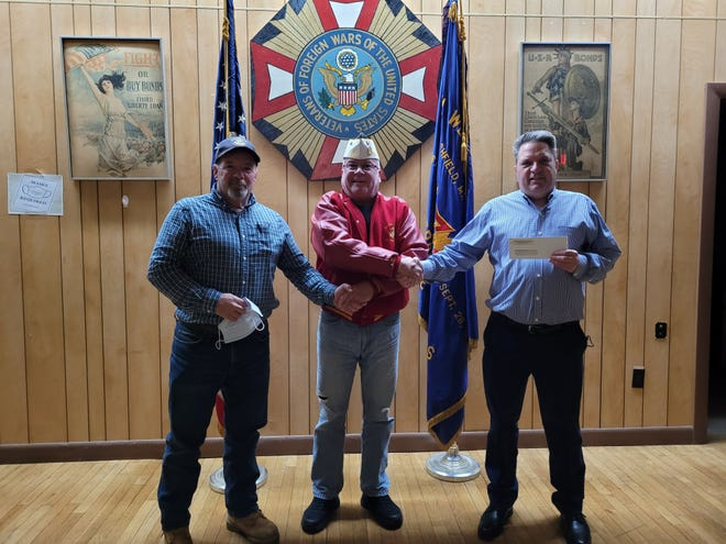 Marshfield's Daniel Webster VFW Post 8345 recently completed its annual Buddy Poppy Drive. Pictured are Bob Mayhew, president of Marshfield Kiwanis; Kevin Feyler, Daniel Webster VFW Post 8345 Commander; and Keith Demers, Loyal Knight of Marshfield Elks Lodge 2494.