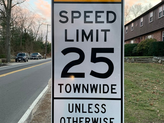 A sign posted in Scituate noting a town-wide 25 mph speed limit.