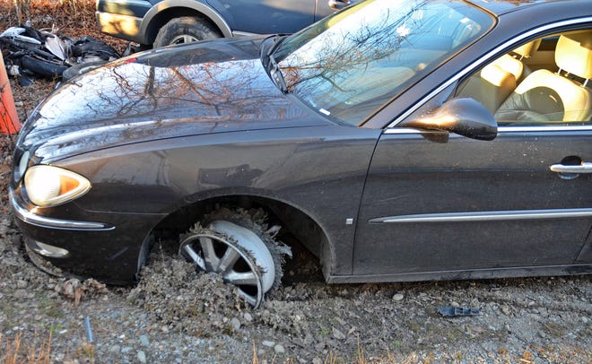 A Roslindale man drove his car, which was missing a tire, onto a Hull beach before being arrested by Hingham and Hull police.