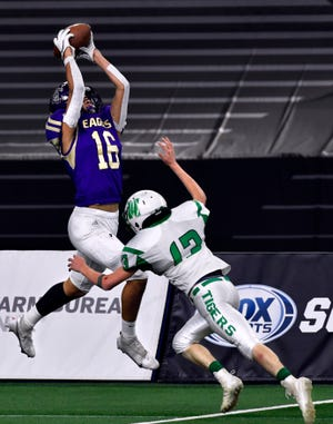 Sterling City wide receiver Damian Calderon is knocked out of bounds by May defensive back Aaron McGinn during the Six-Man Class 1A Division I state championship at AT&T Stadium Wednesday Dec. 16, 2020. Final score was 68-22, Sterling City.