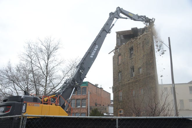 Crews began demolition in Battle Creek of the six-story Binder Building on Wednesday, more than a year after the city determined the building was unsafe.