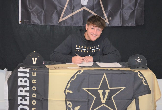 Marshall standout Ezra McAllister signs his National Letter of Intent to play football at Vanderbilt on Signing Day.