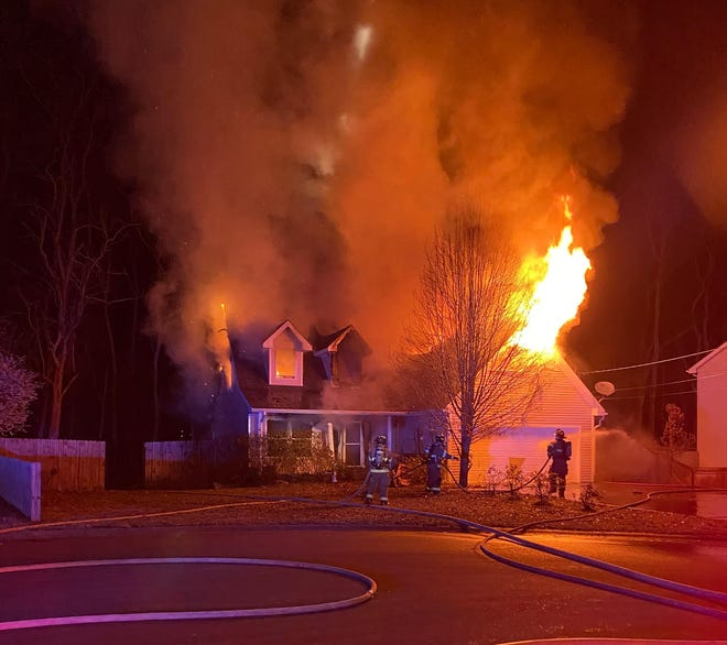 A North Clarksville home catches fire on Cobblestone Lane Wednesday Dec. 16, 2020.