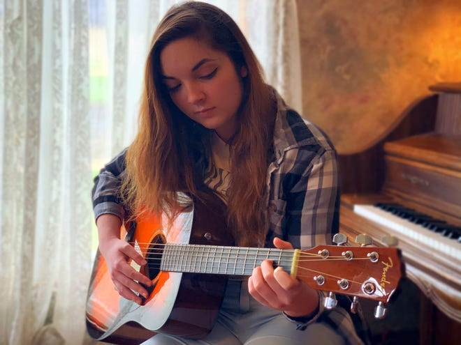 Julia Grimmett, a junior at Ridgewood, is pursuing a career as a singer-songwriter with music online. Earlier this year she participated in the 2020 Adobe Max Concert, held virtually.