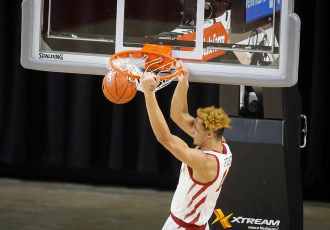 Iowa freshman forward Xavier Foster dunks the ball in the first half against Kansas State on Tuesday, Dec. 15, 2020, at Hilton Coliseum in Ames.