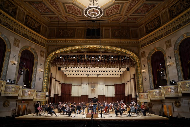 """Detroit Symphony Orchestra music director Jader Bignamini leads musicians in a rehearsal while conducting Beethoven's """"Eroica"""" at the Orchestra Hall in Detroit on Thursday, December 10, 2020 in preparation for an upcoming streaming concert."""
