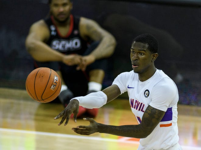 University of Evansville's Thomasi Gilgeous-Alexander (11) makes a pass during the first half against the Southeast Missouri State University Redhawks at Ford Center in Evansville, Ind., Tuesday, Dec. 15, 2020. The Purple Aces defeated the Redhawks 66-63 in overtime.