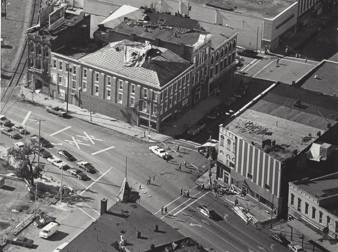 Streets are closed off at Front and State streets in 1977 because of tornado damage.