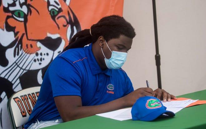 Fort Myers Dunbar High senior defensive lineman Chris Thomas signs with the University of Florida.