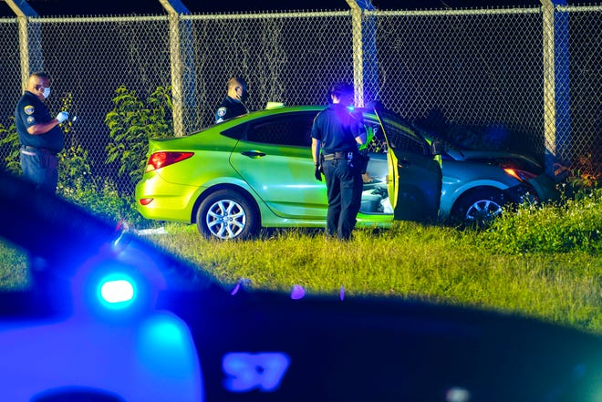 Officers with the Guam Police Department conduct an investigation involving a green Hyundai Accent that crashed into a perimeter fence, along Route 8 in Barrigada, during the evening of Wednesday, Dec. 16, 2020. Cardiopulmonary Resuscitation was performed on the man, who was the only occupant in the vehicle, as he was transported to the Naval Hospital Guam, said Kevin Reilly, Guam Fire Department spokesman.