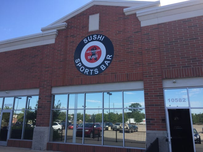 The state has fined Hatorando Sushi and Sports Bar. Owners of the Hartland Township restaurant, shown Friday, Aug. 21, 2020, defied a state COVID-19 order suspending indoor dining.