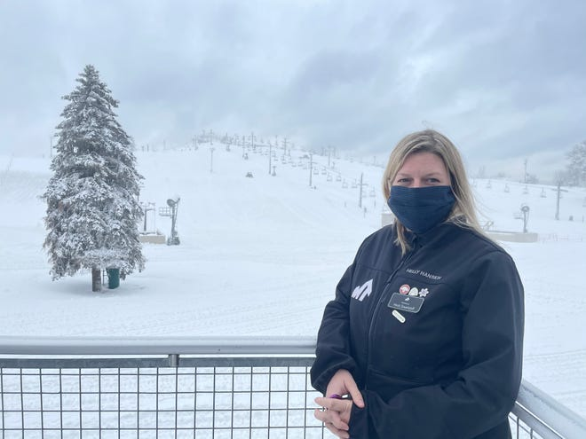 Snow generated by blowers fills the air and covers the slopes at Mt. Brighton while Marketing Manager Heidi Swartzloff talks about reopening plans on Wednesday, Dec. 16, 2020.