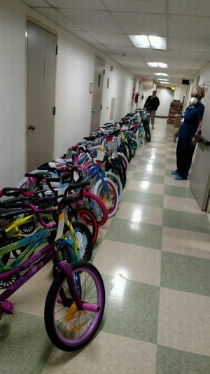 McLaren Greater Lansing employees are donating 27 bikes to Toys for Tots this year.