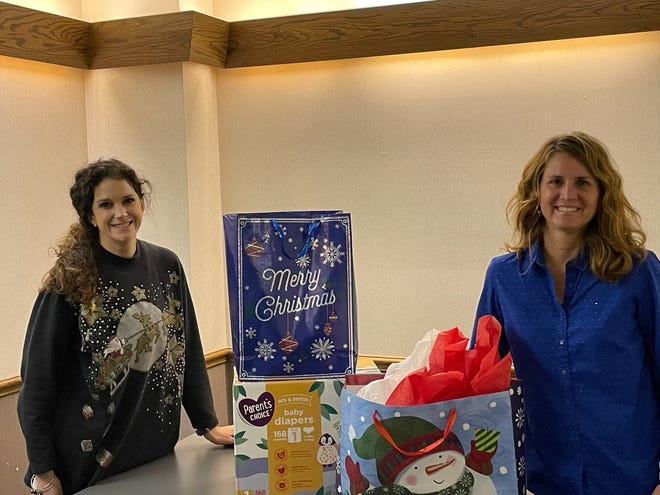Buckeye Community School teacher Angie Lowe, left, and intervention specialist Anna Tinnerello, helped buy gifts for students this Christmas.