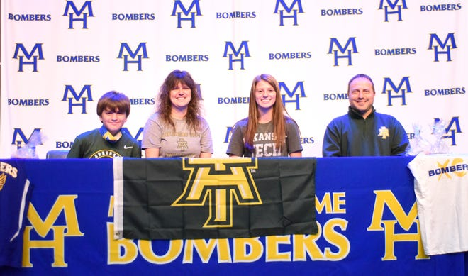 Mountain Home's Marcie Cudworth (third from left) signed a National Letter of Intent to run cross country and track at Arkansas Tech University on Wednesday. Pictured with Cudworth are (from left) brother Tate Cudworth, mother Stephanie Cudworth, and father Chris Cudworth.