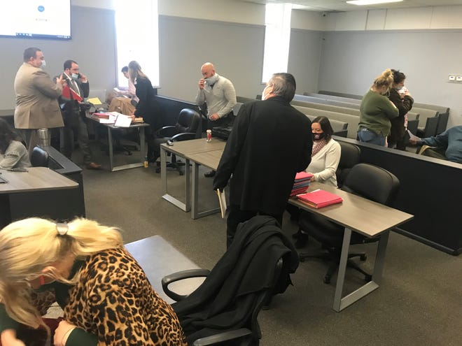Court personnel and citizens prepare to leave Marion County Circuit Court on Wednesday after Circuit Court Judge John Putman canceled court for the day because COVID-19 guidelines set by the Arkansas State Supreme Court were not in place at the Marion County Courthouse.