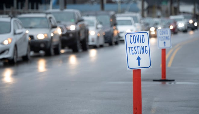 Cars line 2nd St. South with people seeking COVID-19 tests outside a Community Assessment Center at Nissan Stadium Wednesday, Dec. 16, 2020 in Nashville, Tenn.