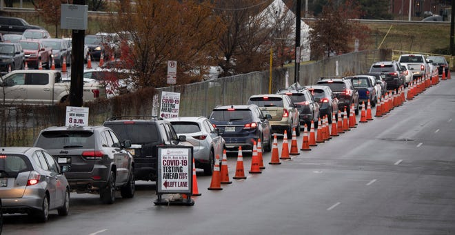 Cars line Sylvan St. with people seeking COVID-19 tests outside a Community Assessment Center at Nissan Stadium Wednesday, Dec. 16, 2020 in Nashville, Tenn.