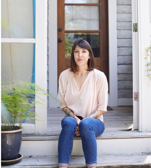 Chef Whitney Otawka sits on porch