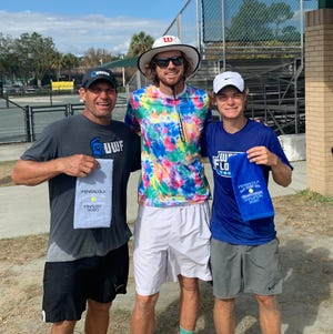 RSTC's Brock Sakey (center) is joined by UWF tennis coach Derrick Racine (L) and his son Luke Racine after Luke won the singles title for the City Clay Court Championships.