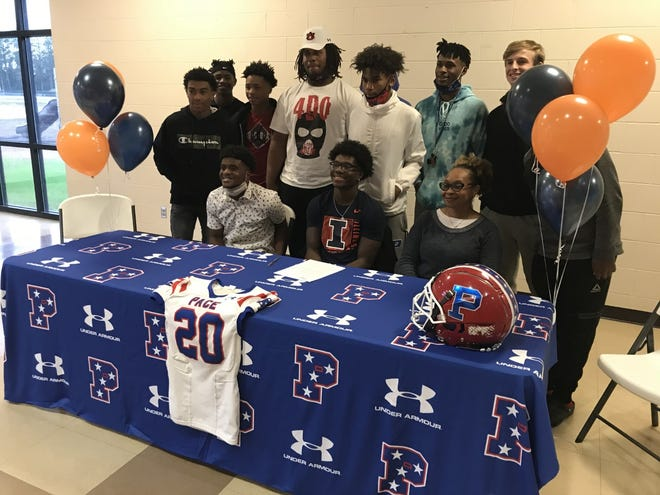 Pace senior Tyler Strain (front, center) poses with family and friends at his signing ceremony on Dec. 16, 2020. Strain signed with the Illinois Fighting Illini.