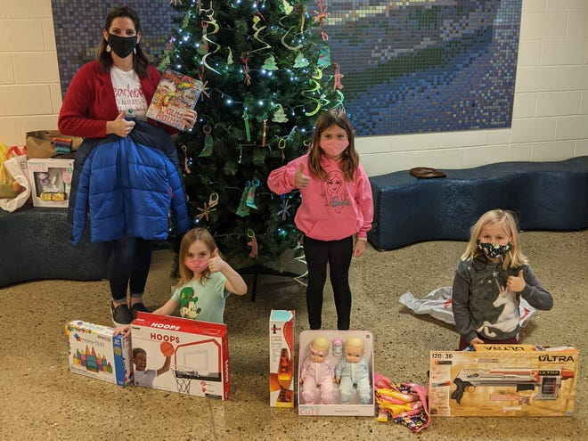 """Christie Miller, first-grade teacher at Bataan Memorial Primary School, along with her students Janelle Toris, Makenna Hatfield and Nora Greener helped local families in need through their """"Angel Tree"""" project with the Salvation Army."""