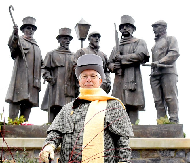 Darryl Engler,the Glen Rock Carolers' music director, stands by the caroler's monument in Glen Rock Borough Wednesday, Dec. 16, 2020. He said the caroler's tradition will carry on this year with COVID-19 modifications. It is his 50th year to participate. Bill Kalina photo