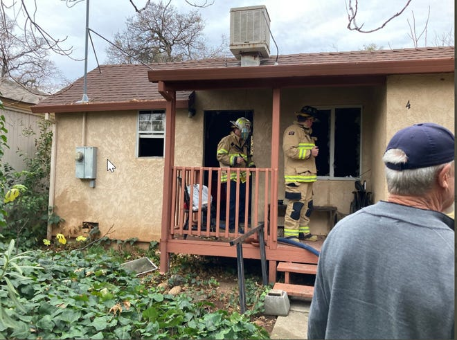 Redding Fire Department investigates after a fire at an apartment on Milo Avenue where a woman was found dead inside.