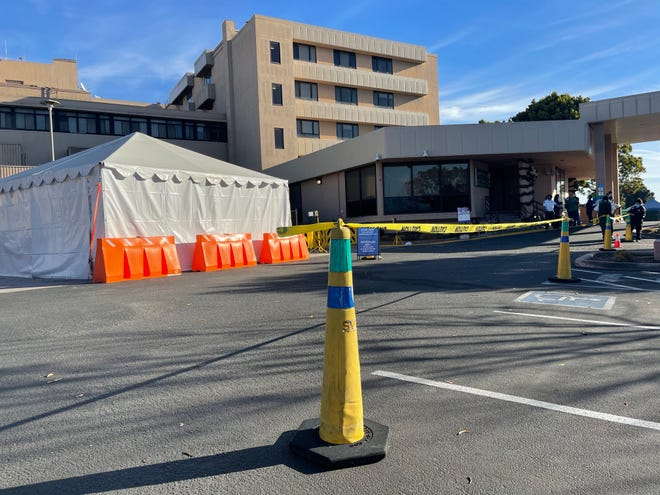 Yellow cones block the parking spots next to a triage tent at Salinas Valley Memorial Healthcare System in Salinas, Calif., on Wednesday, Dec. 16, 2020.