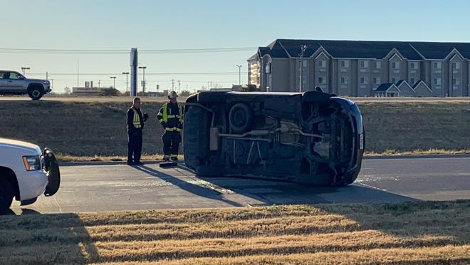 First responders investigate a two-vehicle wreck and rollover in the 4500 block of Houston Harte Expressway on Wednesday, Dec. 16, 2020.