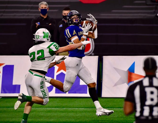 Sterling City's Damian Calderon hauls in a 30-yard touchdown pass from Hudson Cox against May in the Class 1A Division I state football final Wednesday, Dec. 16, 2020, at AT&T Stadium in Arlington.