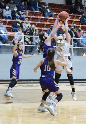 San Saba High School's Landri Glover (middle) defends a shot by Goldthwaite while Madison Shahan (24) and Brighton Adams (10) provide support during a high school girls basketball game Tuesday, Dec. 15, 2020, in Goldthwaite.