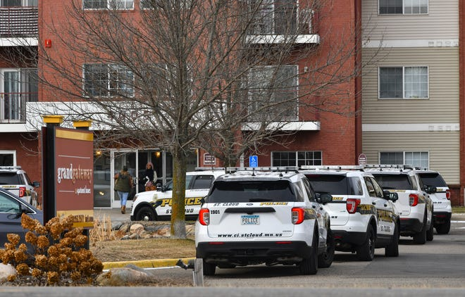 St. Cloud police officers respond to a report of a shooting at the Grand Gateway apartment complex Wednesday Dec. 16, 2020, in St. Cloud.