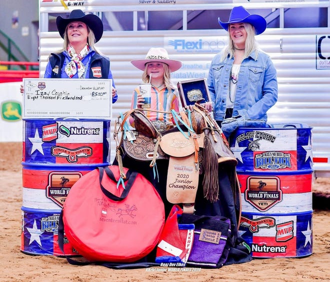 Izzy Coughlin (center) celebrates after winning the 2020 Junior World Finals Rodeo barrel racing championship.