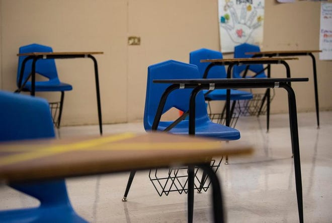 Desks were placed six feet away from each other at Premont Collegiate High School in Premont. Some desks, marked with yellow Xs, were used as placeholders to maintain a socially safe distance.